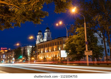 Minsk, Belarus - May 30 2018: Historical center of Minsk City. Famous Lenina Street illuminated at night with Cathedral of Saint Virgin Mary. Upper Town, Minsk