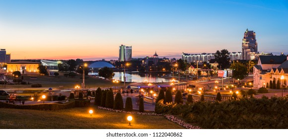 Minsk, Belarus - May 30 2018: Panoramic view of Minsk City center at night with Svislach River embankment, Trinity Hill and Belarus Hotel. Nyamiha and Upper Town are famous tourist districts