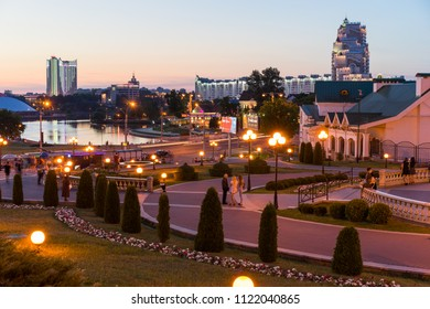 Minsk, Belarus - May 30 2018: Night view of Minsk City center with Svislach River embankment, Trinity Hill and Belarus Hotel. Nyamiha and Upper Town are famous tourist districts