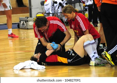 MINSK, BELARUS - MAY 30: Anna LERPER (Germany 10) scoring is injured during European Championship qualifying match (Belarus  Germany) on May 30, 2012 in Minsk, Belarus.