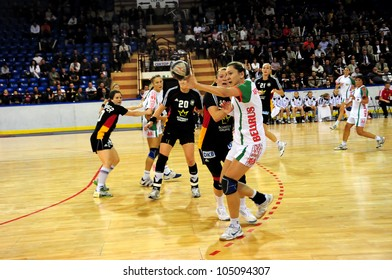 MINSK, BELARUS - MAY 30: Unidentified handball players (Belarus, white) in attack during European Championship qualifying match (Belarus Germany) on May 30, 2012 in Minsk, Belarus.