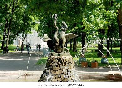Minsk, Belarus - May, 31, 2015: Boy with a swan sculpture in fountain in summer