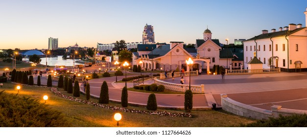 Minsk, Belarus - May 31 2018: Panoramic view of Minsk City center illuminated at night with Svislach River embankment and Orthodox Educational Complex. Upper Town is famous tourist district