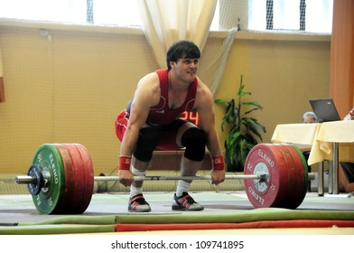 MINSK, BELARUS MAY 31: Unidentified sportsman is trying to take the weight during Belarus Open Championship in weightlifting on May 31, 2012 in Minsk, Belarus