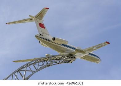 MINSK, BELARUS - MAY 4, 2015: The model of the passenger Tu-134A USSR-65056 plane on a metal pedestal