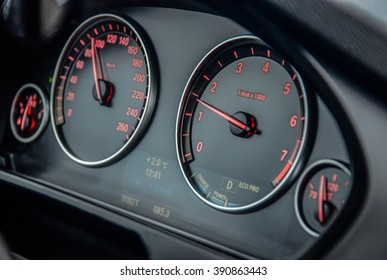 MINSK, BELARUS - MAY 6, 2015: close up image of BMW X5 M50d dashboard with speedometer and tachometer at the test drive in Minsk, Belarus.