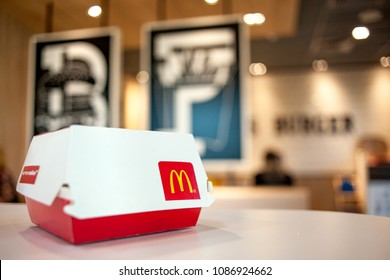 Minsk, Belarus, May 6, 2018: Big Mac Box with McDonald's logo on table in McDonald's Restaurant