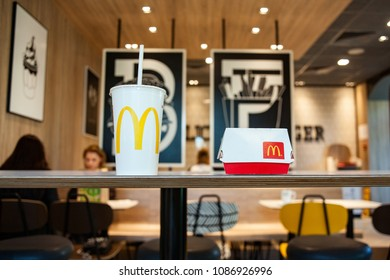 Minsk, Belarus, May 6, 2018: Big Mac Box and soft drink with McDonald's logo on table in McDonald's Restaurant