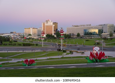 """Minsk, Belarus - May 6 2018: Panoramic view of Pobediteley Avenue from monumental complex """"Minsk - Hero City"""" at sunset during Victory Day celebrations. Minsk City center"""