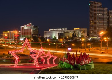 """Minsk, Belarus - May 7 2018: Panoramic view of Pobediteley Avenue from monumental complex """"Minsk - Hero City"""" illuminated in the evening during Victory Day celebrations. Minsk City center"""