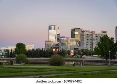 Minsk, Belarus - May 7 2018: Pobediteley Avenue at sunset viewed from Central Park. Svislach River embankment, Minsk City Center
