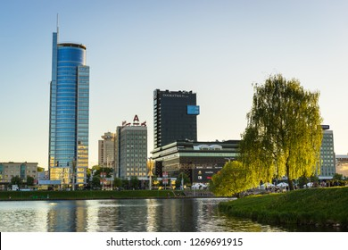 Minsk, Belarus - May 7 2018: Minsk skyline. Svislach River embankment at sunset with Royal Plaza, Hotel Doubletree by Hilton and Galleria Minsk shopping mall. Nemiga District