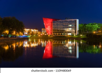 Minsk, Belarus - May 8 2018: Modern office building shaped as a red crystal. Development Bank headquarters, Minsk downtown