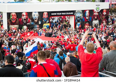 MINSK, BELARUS - MAY 9 - Swiss and Russian Fans with Flags in Front of Minsk Arena on May 9, 2014 in Belarus. Ice Hockey World Championship (IIHF) Opening.