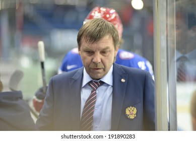 MINSK, BELARUS - MAY 9: Znarok Oleg, head coach of Russia reacts during the IIHF World  Championship match between Russia and Switzerland at Minsk Arena on May 9, 2014 in Minsk, Belarus.