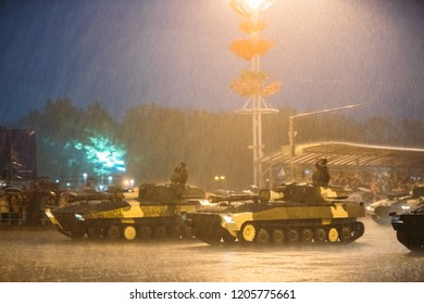 Minsk, Belarus. Military Self-propelled Howitzers Gvozdika Moving At Street During Rehearsal Before Celebration Of Independence Day Of Belarus. Evening Rainy Time.