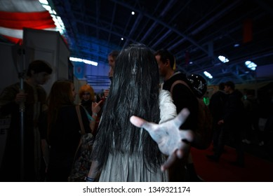 Minsk, Belarus - Nov 2018. Cosplayer as characters Samara from horror movie - The Ring, during Unicon Convention. Dead hand. Cosplayers demonstrate costume, makeup and dressing skills at Game Expo