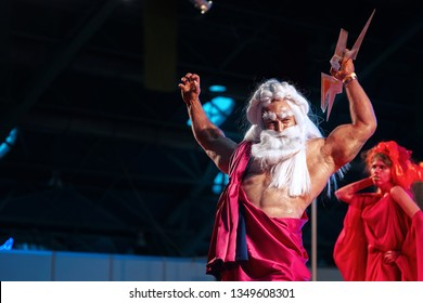 Minsk, Belarus - Nov 2018. Cosplayer as character Zeus - thunder god in ancient Greek religion. Athlete with lightning in hands. Cosplayer demonstrate costume and dressing skills at  Unicon Convention