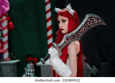 Minsk, Belarus - Nov 2018. Katarina - Pretty female character with two swords from League of Legends. Model girl cosplayer at Unicon Convention. Cosplayers demonstrate their costumes at Game Expo