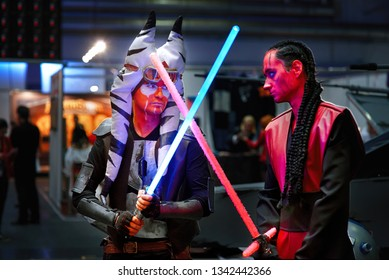 Minsk, Belarus - Nov 2018. Star Wars cosplay, during Unicon Convention. Lightsaber battle between Darth Maul and Ahsoka Tano. Cosplayer demonstrate costume, makeup and dressing skills at Game Expo