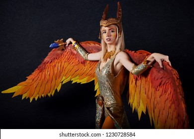 MINSK, BELARUS - NOVEMBER 03, 2018: UniСon Convention & Game Expo Minsk 2018. Cosplayer young woman dressed as Phoenix from Dota 2 shoot on black background in photo zone