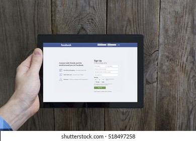 Minsk, Belarus - November 10, 2016: Open Facebook Page Sign Up on Black Tablet PC. Largest social network in the world. Founded February 4, 2004 by Mark Zuckerberg, E.Saverin, D.Moskovitz, C.Hughes.