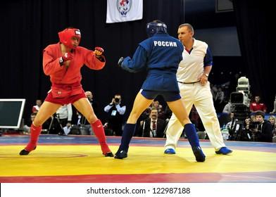 MINSK, BELARUS - NOVEMBER 10: Ivanov A. from Russia (blue) VS Velichkov B. from Bulgary during the final match SAMBO (Wrestling) WORLDCh-2012 on November 10, 2012 in Minsk, Belarus.