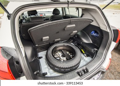 MINSK, BELARUS - NOVEMBER 14, 2015: 2015 model year Kia Sportage at the test-drive. Photo of the trunk and the spare wheel.
