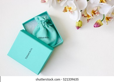 Minsk, Belarus - November 14, 2016: Luxury, trendy jewelry Tiffany box. The world-famous American fashion brand. Editorial illustrative.  Best gift for Valentines Day and Mothers day.