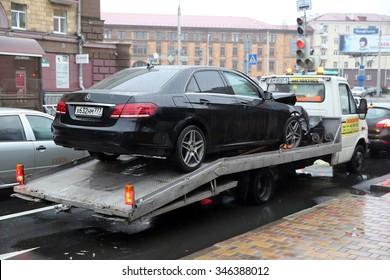 MINSK, BELARUS - NOVEMBER 19, 2015: crashed Mercedes from Moscow is towed in Minsk