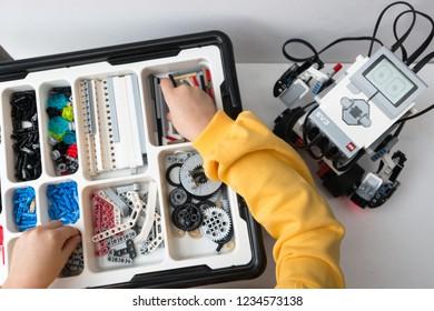 Minsk, Belarus. November, 2018. Cute little schoolgirl constructs the Girobot Lego Mindstorms EV3 Robot. Modern training. The hottest gadgets. E-learning. Modern teaching technology. STEM education.