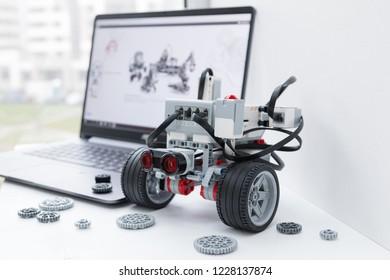 Minsk, Belarus. November, 2018.  Robotic car. Robot Lego Mindstorms EV3. STEM education. Hand show like. Technology and programming robotics.