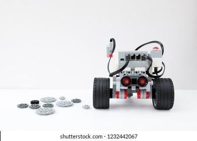 Minsk, Belarus. November, 2018.  Robotic car. Robot Lego Mindstorms EV3. STEM education. Hand show like. Technology and programming robotics. Laptop.