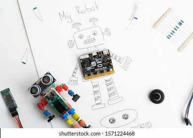 Minsk, Belarus. November, 2019. The BBC robot Micro Bit is near the robot. It can be programming on Scratch and Python. Creative. Connected. Coding. Learning, teaching easy and fun. Free space text.
