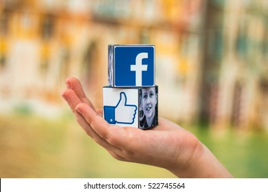 Minsk, Belarus - November 25, 2016:The most popular social network in the world. Facebook logo on the hand.Like me on... I like it. I love it.