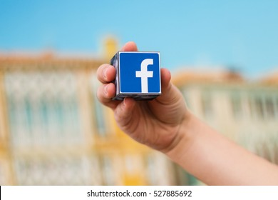 Minsk, Belarus - November 25, 2016:The most popular social network in the world. Facebook logo on the hand.
