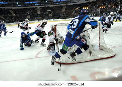MINSK, BELARUS - NOVEMBER 28: Unidentified Dynamo players  in attack during KHL regular match Dynamo Minsk VS Avtomobilist  Yekaterinburg on November 28, 2012 in Minsk, Belarus.