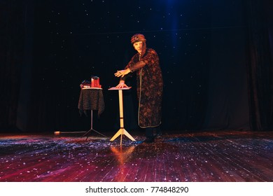 MINSK, BELARUS November 4 2017 International Illusion Festival MAGIC 2017 Male magician shows a performance with a raised table