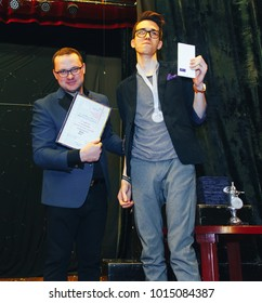 MINSK, BELARUS November 5 2017 International Illusion Festival MAGIC 2017 Man and guy with a diploma posing in front of the camera