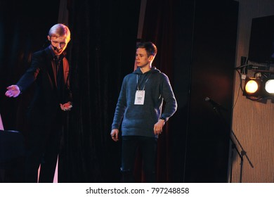 MINSK, BELARUS November 5 2017 International Illusion Festival MAGIC 2017 A young magician with an assistant shows the performance on stage