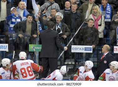 MINSK, BELARUS - NOVEMBER 6: Andrei Nazarov(C) coach of HC Vityaz fights with fans during match HC Dinamo-Minsk - HC Vityaz on Kontinental Hockey League(KHL) on November 6, 2011 in Minsk, Belarus