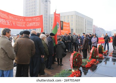 MINSK, BELARUS - November 7, 2014: Communism supporters at Belorussian Communist party meeting on Great October revolution celebration at Independence square