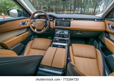 MINSK, BELARUS - NOVEMBER 7, 2017: Photo of Range Rover Velar's interior. Interior features caramel-browm leather trim on seats and dashboard. Range Rover Velar's cabin exudes elegant simplicity.
