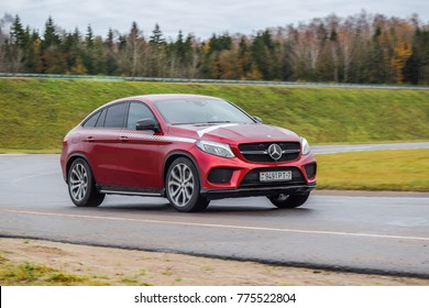 MINSK, BELARUS - NOVEMBER 7, 2017: Mercedes-AMG GLE 43 4MATIC Coupe on a test-drive. Bright red coupe-crossover drives on a road. Its 3.0-liter V6 biturbo engine produces 367 hp of power.