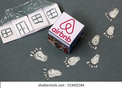 Minsk, Belarus - November 9, 2016: Travel around the world with Airbnb. Origami Paper  house. Logo Airbnb.