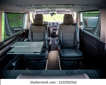 MINSK, BELARUS - OCTOBER 16, 2018: Image of interior of sixth generation of Volkswagen Multivan with foldable table and swivel captain's chairs in the second row.