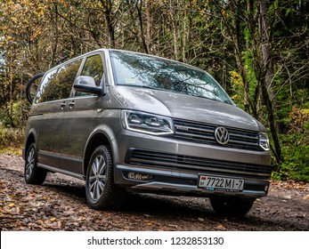 MINSK, BELARUS - OCTOBER 16, 2018: Sixth generation of Volkswagen Multivan PanAmericana in a narrow forest road. This is a rugged-looking model equipped with all-wheel drive transmission.