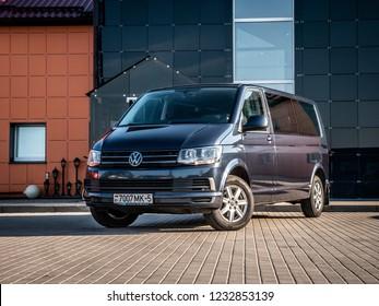 MINSK, BELARUS - OCTOBER 16, 2018: Sixth generation of Volkswagen Caravelle parked in front of a building. Caravelle is a multi-functional van or bus designed for various transportation tasks.