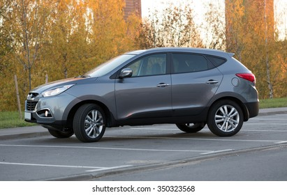 Minsk, BELARUS - OCTOBER 19, 2013: New Hyundai ix35 Imported from Moscow to Minsk. The car is parked on a street in Minsk.