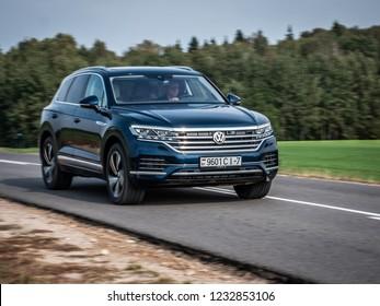 MINSK, BELARUS - OCTOBER 2, 2018: Third generation of Volkswagen Touareg drives along a narrow road during test drive.